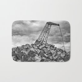 Crane with scrap metal Bath Mat