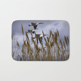 Geese flying in for a landing Bath Mat