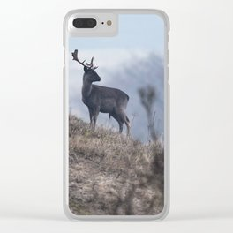 Dark fallow deer on slope of misty dune. Clear iPhone Case