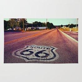 U.S. Route 66 highway, with sign on asphalt on Missouri. Rug