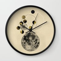 moon phase Wall Clocks featuring Moon by J Arell