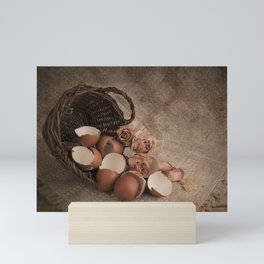 Basket with egg shells and roses Mini Art Print