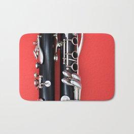 clarinet red background Bath Mat