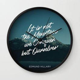 It is not the mountains we conquer but ourselves Wall Clock