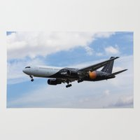 titan Area & Throw Rugs featuring Titan Airways Boeing 767 by David Pyatt