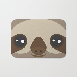 funny and cute smiling Three-toed sloth on brown background Bath Mat