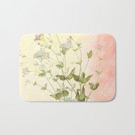 The air the flower breathes Bath Mat