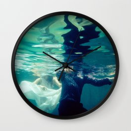 Chasing love Wall Clock