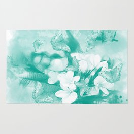 Butterflies and tropical flowers in stunning teal Rug