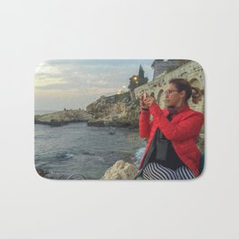 Woman taking a picture in a beach in the Rovinj city center Bath Mat