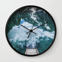A staircase leading to the water in an mountain lake in the Dolomites Wall Clock
