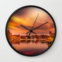 jamaica Wall Clocks featuring Sunset over Jamaica Pond by LudaNayvelt