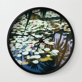 Lily Pads In Water Reflecting Palm Trees Wall Clock