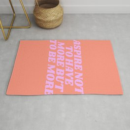 aspire not to have more but to be more Rug