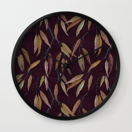 Eucalyptus leaves in autumn colors on plum violet Wall Clock