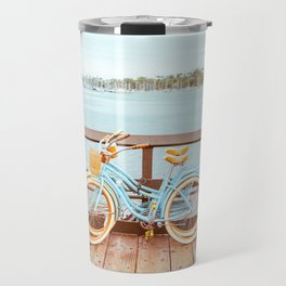 Two retro bicycles standing on Santa Barbara pier, California, USA. Vintage filter with muted teal blue and orange colors. Travel Mug