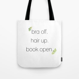 Bra off. Hair up.  Book open. Tote Bag