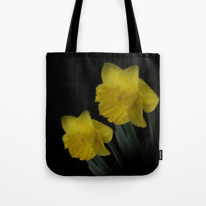 golden daffodils on black Tote Bag