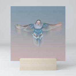 Pale blue flying lovebird Mini Art Print