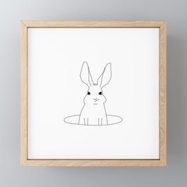 rabbit in a hole Framed Mini Art Print