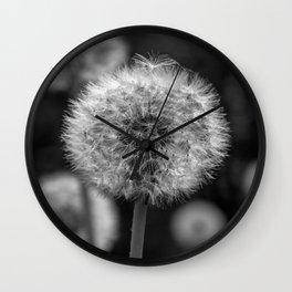 Monochromatic dandelion on black Wall Clock