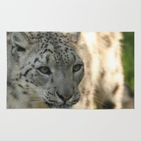snow leopard Area & Throw Rugs featuring Snow Leopard by Sean Foreman