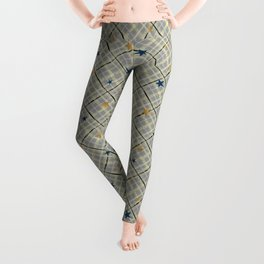 Gold and blue stars on a gray checkered background . Leggings
