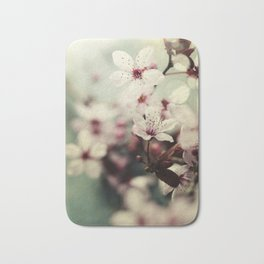 Spring blossom on rustic wooden table Bath Mat