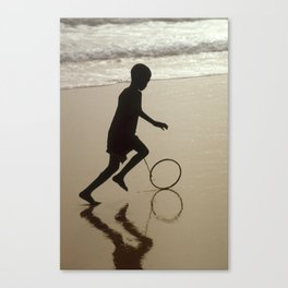 Silhouette on an African Beach. Canvas Print