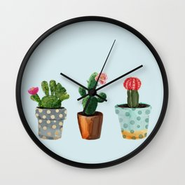 Three Cacti With Flowers On Light Blue Background Wall Clock