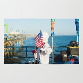 cosmonaut Santa Monica pier Rug