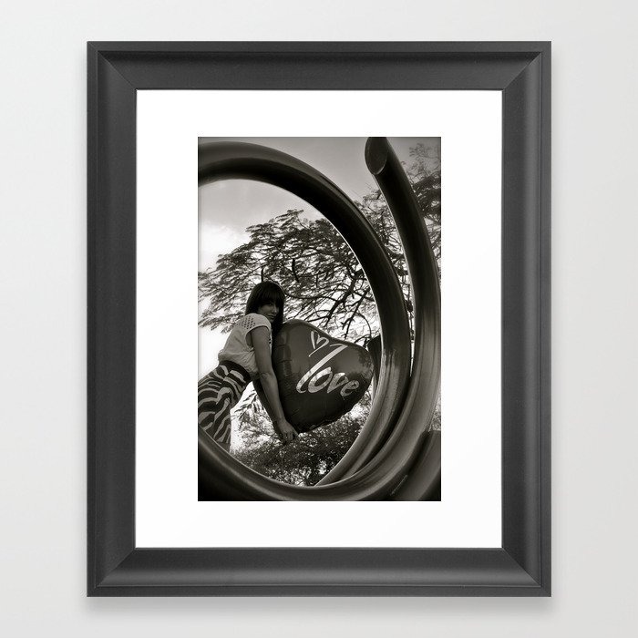 Circled love Framed Art Print