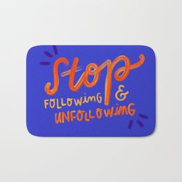 Unfollowing sheep Bath Mat