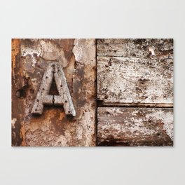 Weathered wood letter A Canvas Print