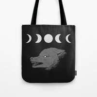 moon phase Tote Bags featuring Just a Phase by Morgan