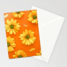 Gerbera spring flowers arranged on a orange background Stationery Cards