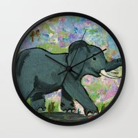 baby elephant Wall Clocks featuring Baby Elephant by gretzky