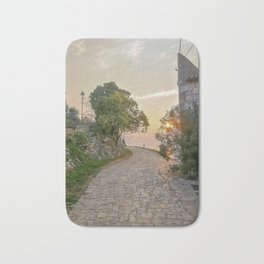 Little alley in the medieval center of the village Rovinji at sunset Bath Mat