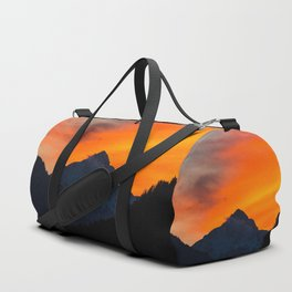 Stunning vibrant sunset behind mountain Duffle Bag