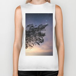 Amazing starry scene. Silhouette of a tree with colorful starry sky. Biker Tank