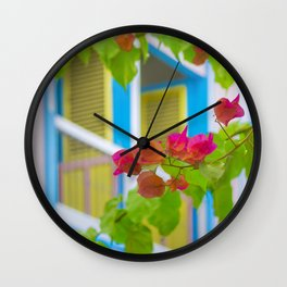 Colored Flowers in Front of Windows House Wall Clock