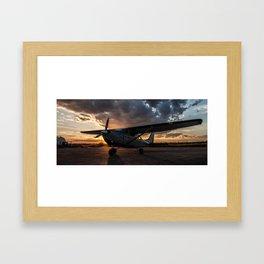 Cessna 206 during sunset Framed Art Print