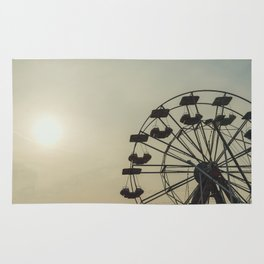 Ferris wheel in a Luna Park shortly before sunset in autumn Rug
