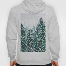 snowy pine forest in green Hoody