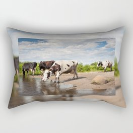 Herd of cows walking across puddle Rectangular Pillow