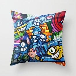 Graffiti Urban colorful graffiti city wall comical cartoon fish with big eyes doing graffitis Throw Pillow