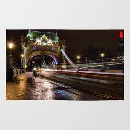 Night shot of traffic light trails on Tower Bridge London Rug