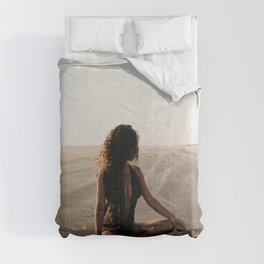 WOMAN - SITTING - ON - SAND - PHOTOGRAPHY Comforters
