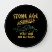 queens of the stone age Wall Clocks featuring Stone age Animal by lilbudscorner