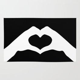 Hands making a heart shape- portraying love Rug
